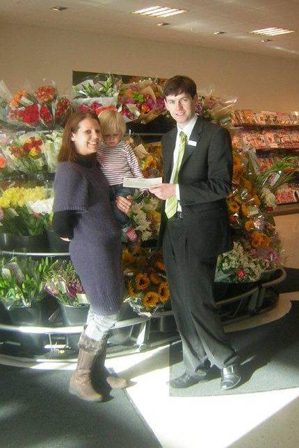 Grimsar Toddlers receive cheque from Waitrose